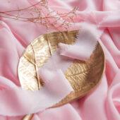 Wstążka z postrzępionymi brzegami pastelowy róż